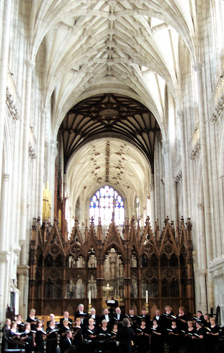 The high-vaulted Winchester Cathedral, with choristers