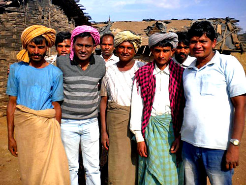 An Augustinian (second from left) visits a village in Central India