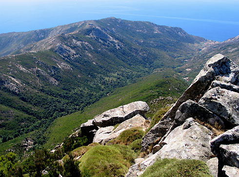 The rugged costal edge of Tuscany, photographed from Monte Capanne and showing the Pomonte Valley.