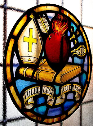 Augustinian crest in stained glass at the Priory in Hammersmith, London