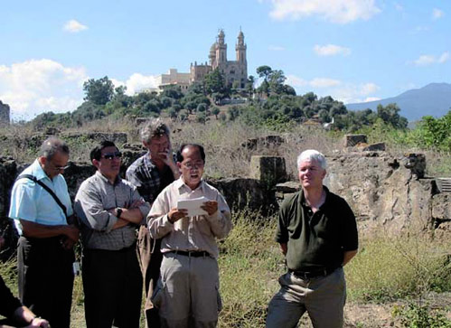 Augustinians visit Hippo, with Annaba high in the background