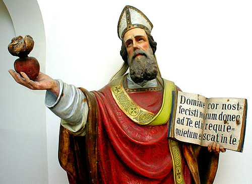 Wooden statue of St Augustine near his tomb at Pavia.