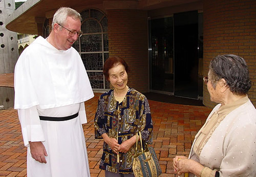 An Augustinian chats in front of the Augustinian church, Nagasaki.