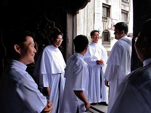 Young Augustinians at the San Agustin church door at Intramuros, Manila.