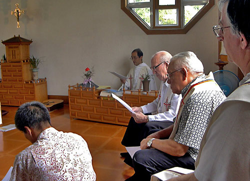 Prayer at the community chapel at Kang-Hwa, south Korea.