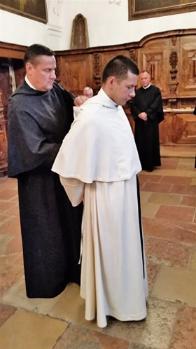 Receiving the Augustinian white habit.