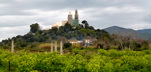 The green foreground is Hippo. The church on the hill in the distance is the present Minor Basilica of St Augustine, Annaba, Algeria.