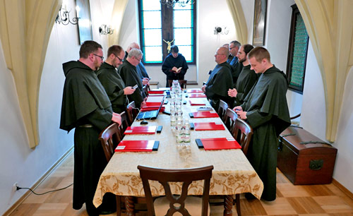 A Polish Augustinian community prays before a meeting